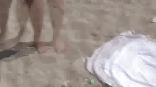 Oily teen flashing on the beach