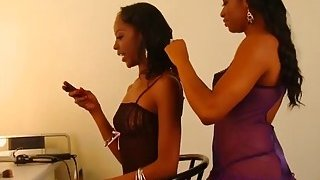 Two very hot ebony babes in a sexy lingerie take care for one another pussy