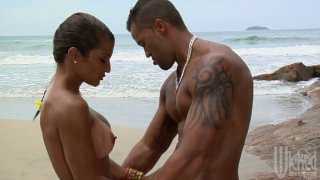 Sexy couple of Claudia Bella and her handsome boyfriend get horny on the beach
